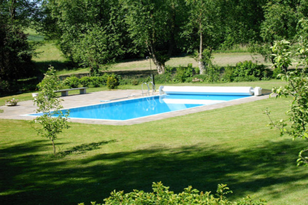 Construction piscine b ton en seine maritime for Piscine jardin